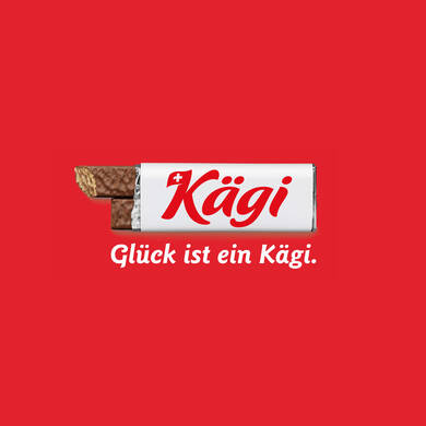 Kägi_Brandlogo-incl.-Claim-(on-red-background)_left-facing_CMYK_German